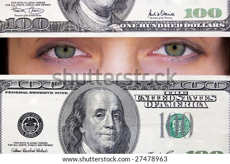 Green female eyes looking through hundred dollars banknote. - stock photo