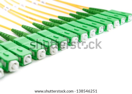 green fiber optic SC connectors on white background - stock photo