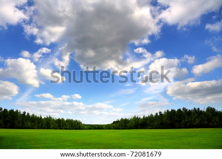Green field and beautiful sky, nature background - stock photo