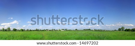 Green field and blue sky panorama - stock photo