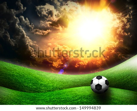 green field and blue sky with soccer ball - stock photo