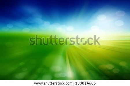 Green field and blue sky with white cloud - stock photo
