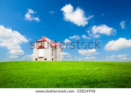 green field and house - stock photo