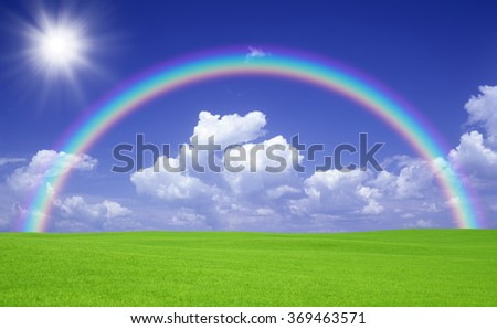 Green field and rainbow - stock photo