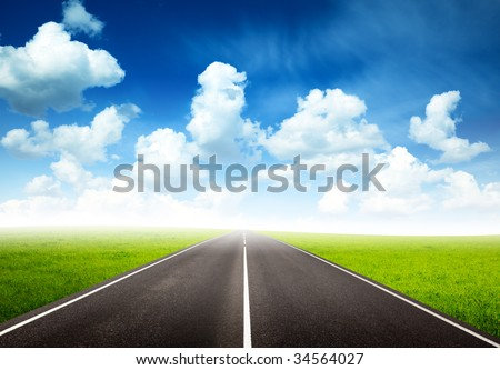 green field and road - stock photo