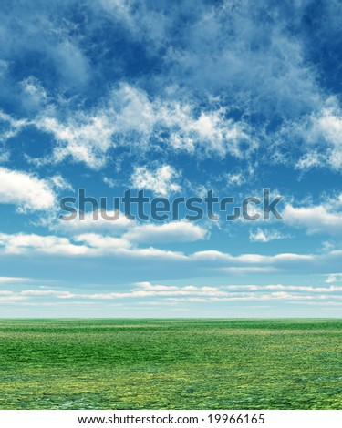Green field and sky with fluffy clouds