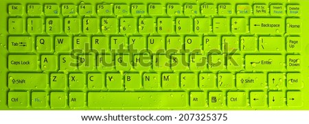 green field keyboard computer with dewdrop - stock photo