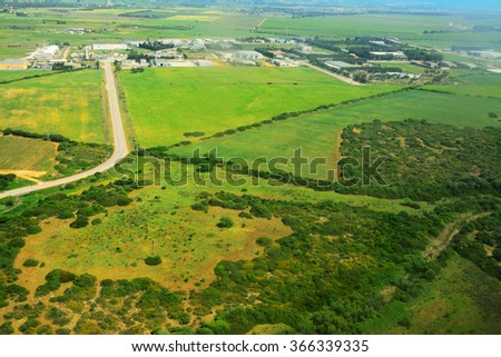 green field seen from above in Sardinia, Italy - stock photo