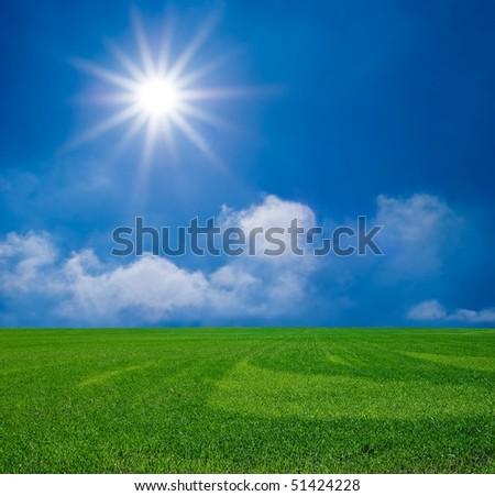 green field under a sparkle sun - stock photo