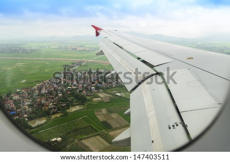 green field view from the airplane window - stock photo