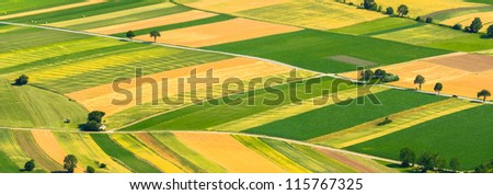 Green fields aerial view with roads - stock photo