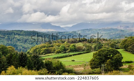 Green fields with mountains in the distance, Snowdonia Wales