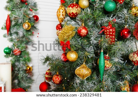 Green fir-tree with red and gold Christmas toys