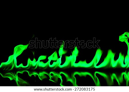 Green fire flames on black background - stock photo