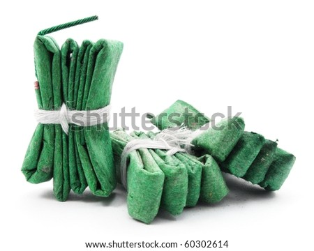 green firecracker isolated on white background showing new year concept - stock photo