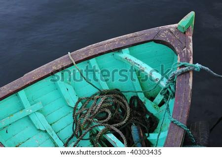 Green fishing boat - stock photo