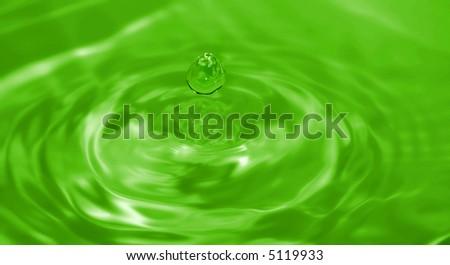 Green fluorescent drop - stock photo