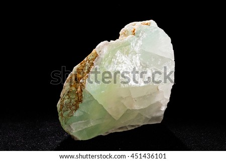 green fluorite from Bulgaria on the black background