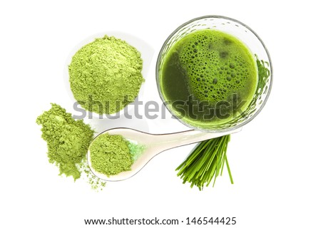 Green food supplement. Spirulina, chlorella and wheatgrass. Green pills, wheatgrass blades and ground powder isolated on white background, top view. Healthy lifestyle.  - stock photo