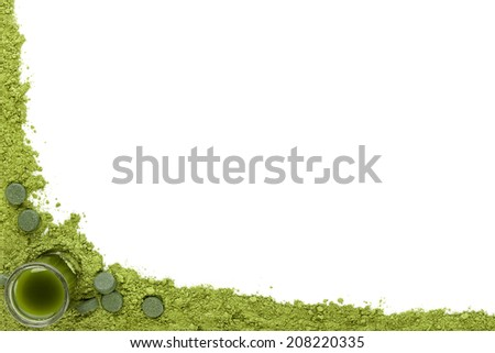 Green food supplements background. Ground powder, green pills and green drink on white background with copy space. Alternative medicine, healthy living. - stock photo