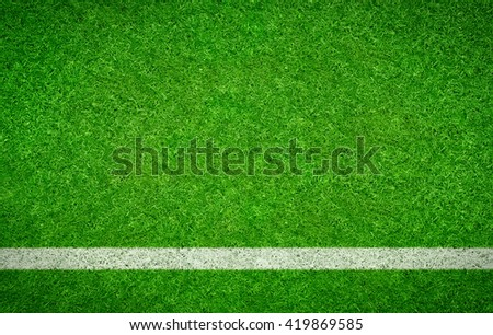 Green Football background with a horizontal line - stock photo