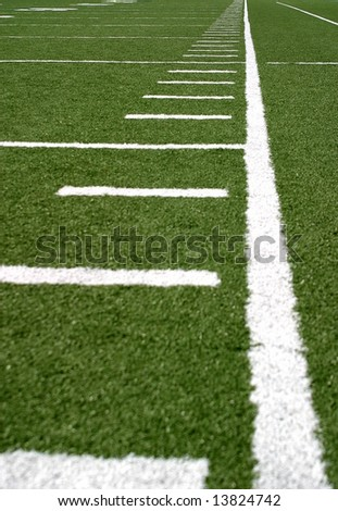 Green football field with large yard markers.