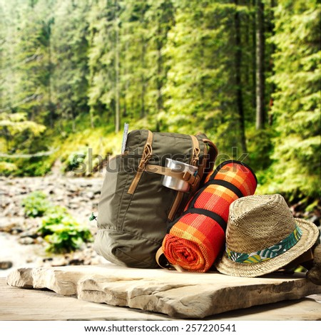 green forest river and big bag  - stock photo
