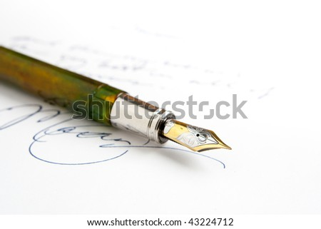 Green Fountain Pen with Obscured Writing - stock photo