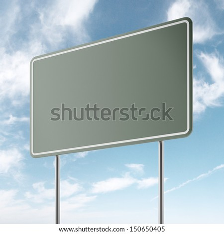 green freeway sign and sky - stock photo