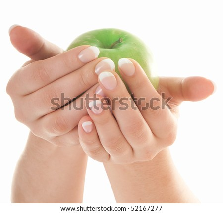 Green fresh apple in beautiful female hands with nice french manicure isolated on white background - stock photo