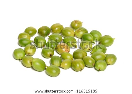 Green fresh coffee beans on white - stock photo