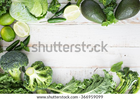 Green fresh fruit and vegetables copy space on white table - stock photo