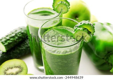 Green fresh healthy juice with fruits and vegetables on white background - stock photo