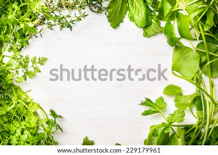 Green fresh herbs mix on white wooden background , top view - stock photo