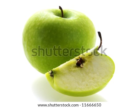 green fresh ripe apple with a slice over white background. Shallow DOF focus on pulp