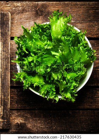 Green fresh  salad on rustic background