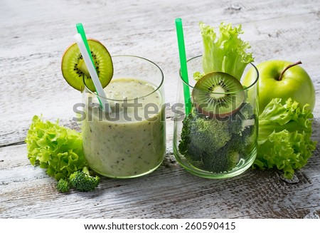 Green fresh smoothie with kiwi, apple, salad and broccoli, healthy drink. Selective focus - stock photo