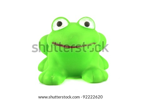 green frog toy on white