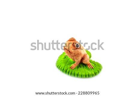 Green frog toy on white background for decorate garden - stock photo