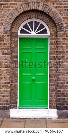 Green front door. - stock photo