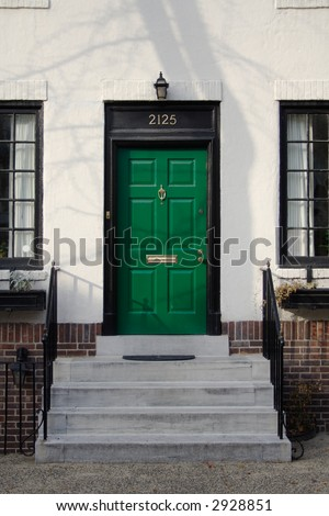 Green front door and steps.  Philadelphia, PA. - stock photo