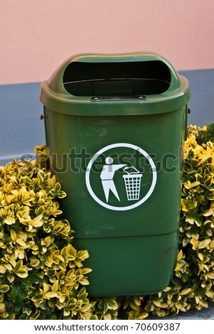 Green garbage can from the street - stock photo