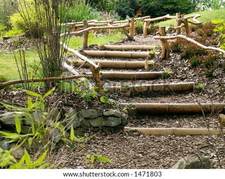 green garden and wood stairs - stock photo