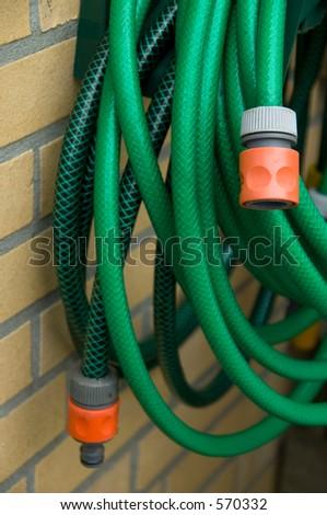 green garden hose - stock photo