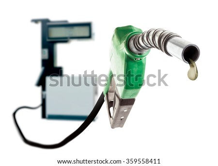 Green gas nozzle with one last drop of fuel and the station on white background - stock photo