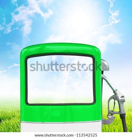 Green gasoline fuel pump ecology concept with landscape background, clipping path - stock photo