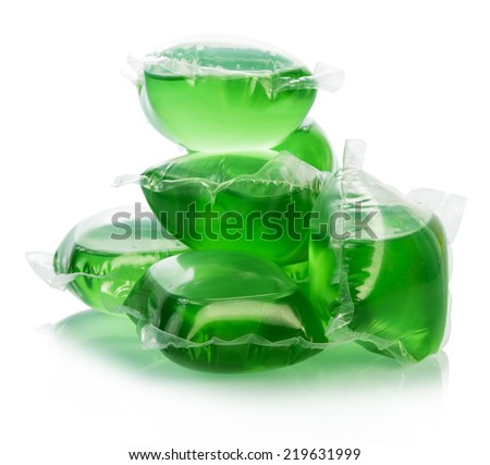 Green gel capsules with laundry detergent on a white background - stock photo