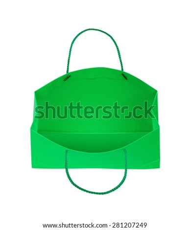 Green gift bag falls through the air on an isolated white background - stock photo