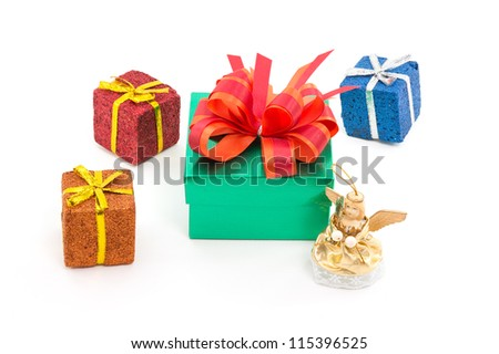 green gift box and christmas decoration on a white background