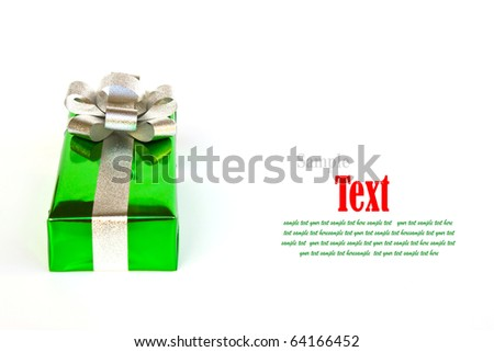 Green gift box decorated with silver ribbon isolated on white background. - stock photo